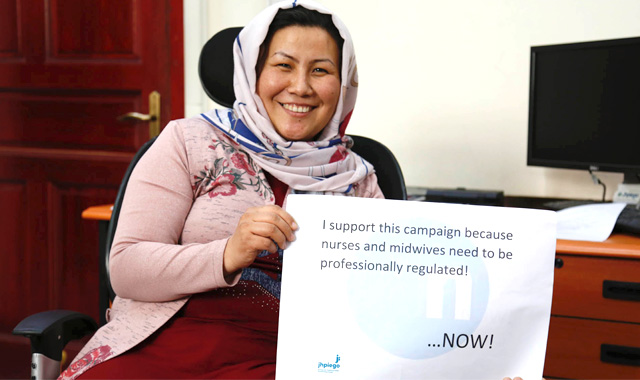Woman holding campaign support sign