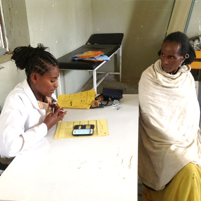 Health extension worker follows protocol on her smartphone