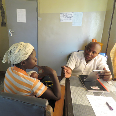 Nurse-Midwife counseling a client